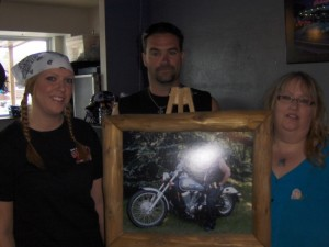 L-R Jessica Sonnenberg, Justin Helmke, Kris Barten and photo of Ole Barten