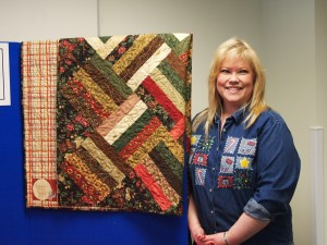 Sandra Gram wins one of the quilts donated in the annual employee potluck.