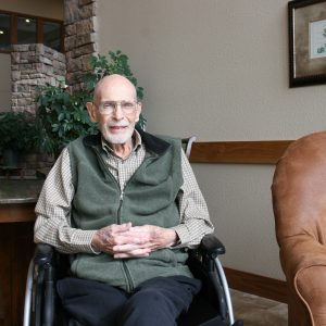 Senior man sitting in wheel chair