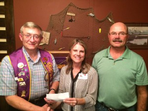 From left: Dr. Mark Malmberg, president of the Oakes Lions Club; Tracy Roche, volunteer coordinator for Hospice of the Red River Valley; Dean Atkinson, treasurer for the Oakes Lions Club