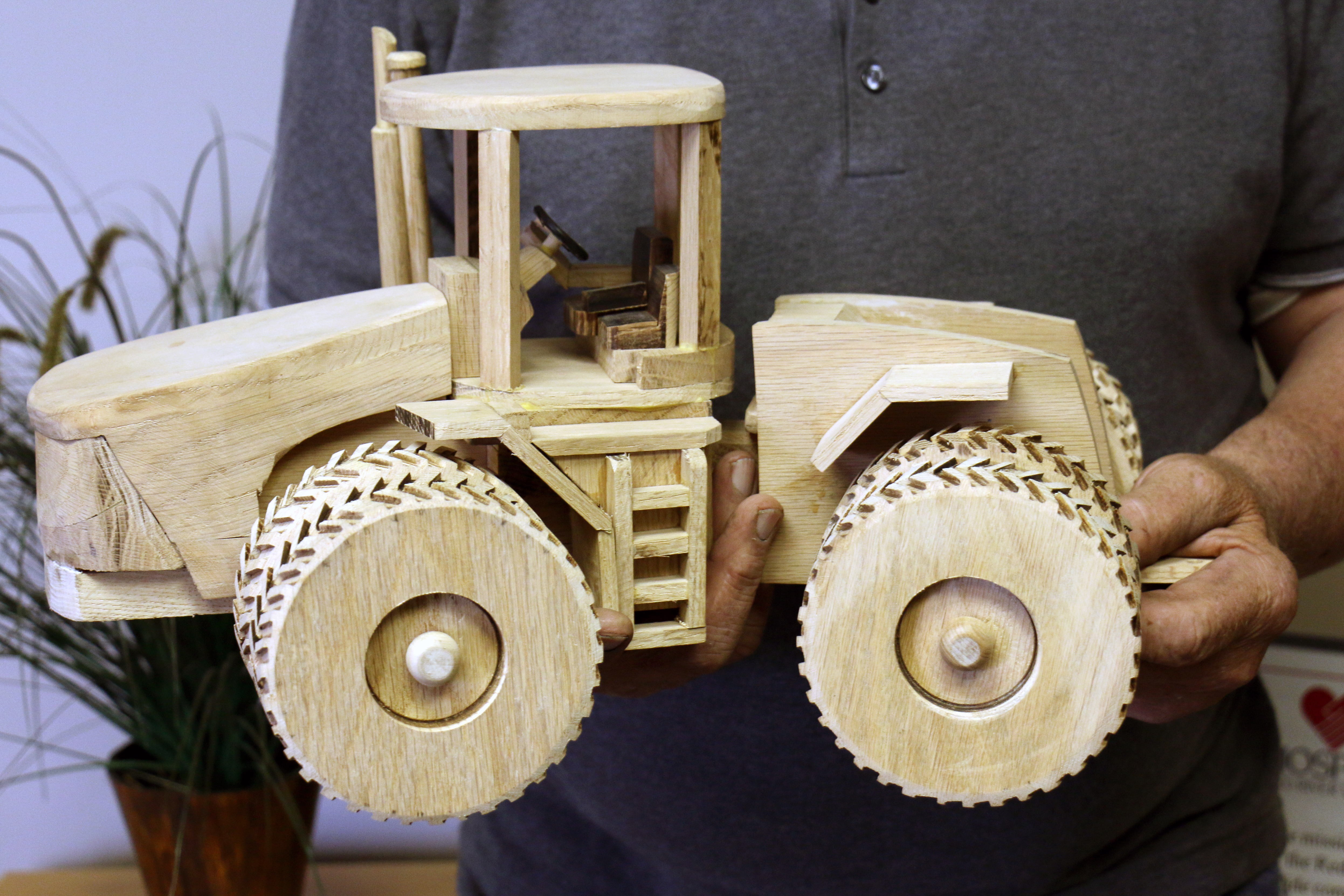 Hand-carved wooden tractor