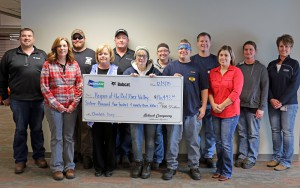 Bobcat Company Employees present a check for more than $16,000 to Hospice of the Red River Valley