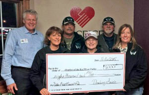The Thundering Saints recently donated $8,000 to Hospice of the Red River Valley. Pictured: (back row) Curt Seter from Hospice of the Red River Valley, Larry Erickson, Rocky Gabel, (front row) Sue Peterson, Edie Johnson and Leah Fadness.