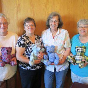 Women holding Celebration bears