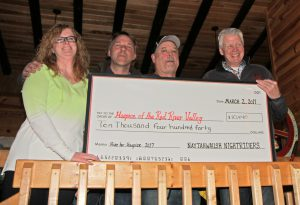 From left to right: Jen and Bill Beckman (pledge winners), event organizer Tom McArthur, and Hospice of the Red River Valley Development Officer Curt Seter
