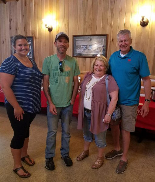 From left to right: Trish Baumann, Reed Bjerk, RibBest organizer Becky Rantanen and Curt Seter, development officer with Hospice of the Red River Valley.