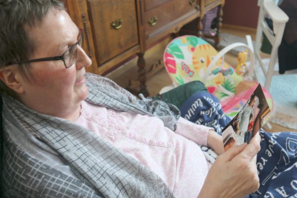 Laurie looks at photos of her grandchildren.