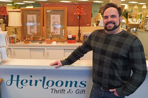 Steve Johnson_Heirlooms Assistant Manager_man standing next to retail counter