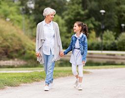 girl walking with grandma