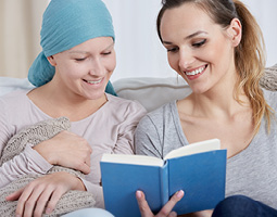 woman reading to another woman