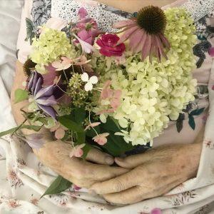 flowers in Grandma's hands