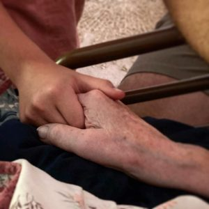 holding hands with grandma