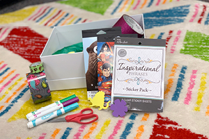 arts and craft supplies, stickers, markers, scissors, box on a colorful rug