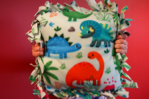homemade pillow with dinosaurs on it